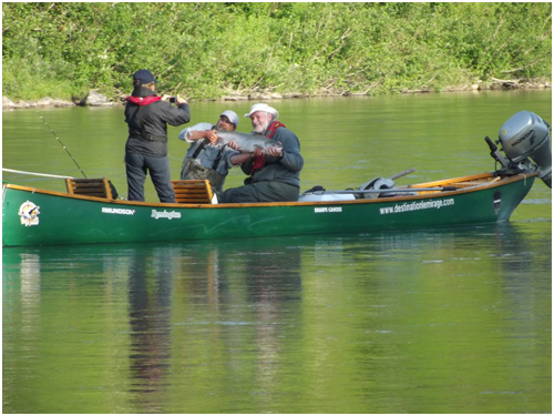 Martin Poisson and a client in action during a fishing trip to Atlantic Salmon on the Bonaventure River